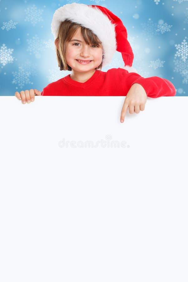 儿童孩子女孩指向愉快的空的横幅纵向格式copyspace拷贝空间的圣诞节圣诞老人项目 免版税库存照片
