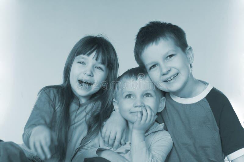 儿童微笑的年轻人 免版税库存照片