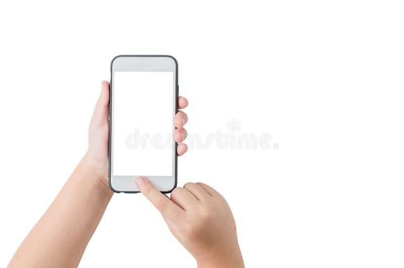 儿童手举行手机和接触在屏幕上 免版税库存图片