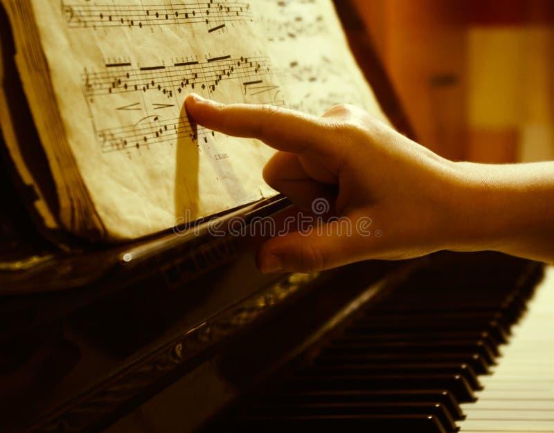儿童手指音乐纸张 免版税库存照片