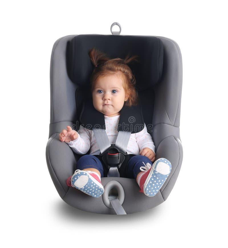 儿童汽车安全位子的可爱的女婴 库存图片
