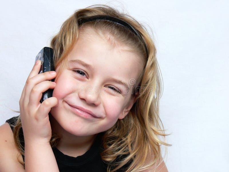 儿童电话谈话 库存照片
