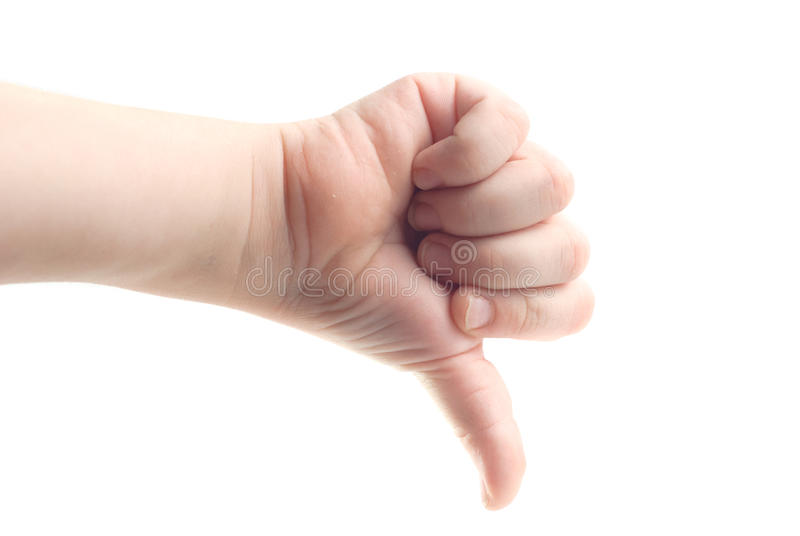 儿童的手,下来拇指,隔绝在白色背景 免版税库存照片