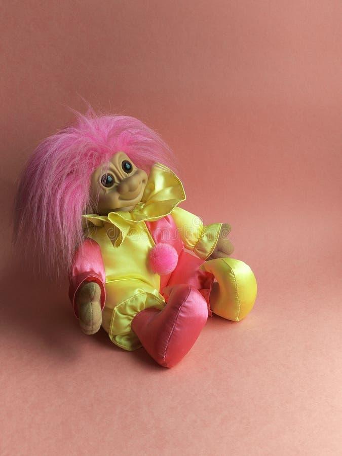 儿童的玩具一个好可笑的拖钓小丑 免版税库存照片