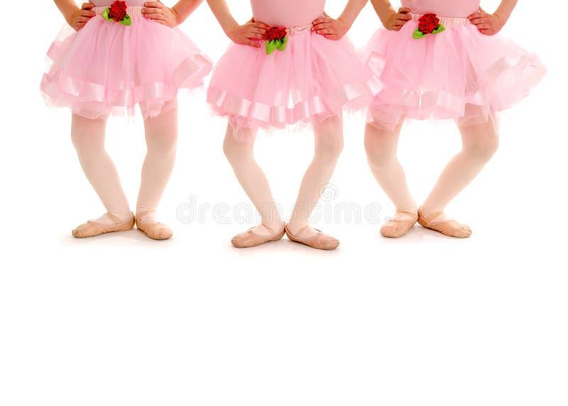 儿童的芭蕾腿在戴米Plie 免版税库存图片