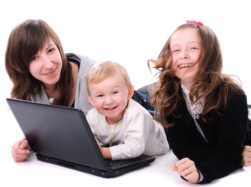 儿童膝上型计算机 库存照片