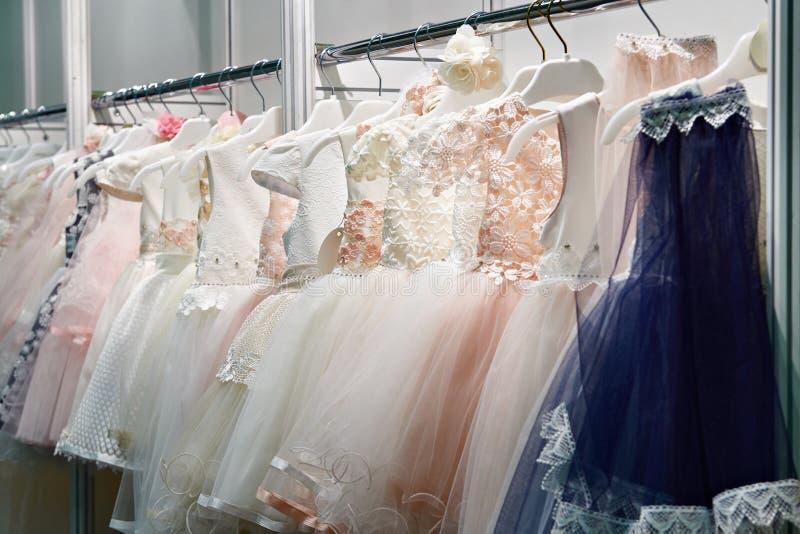 儿童舞厅舞礼服在商店 免版税库存图片