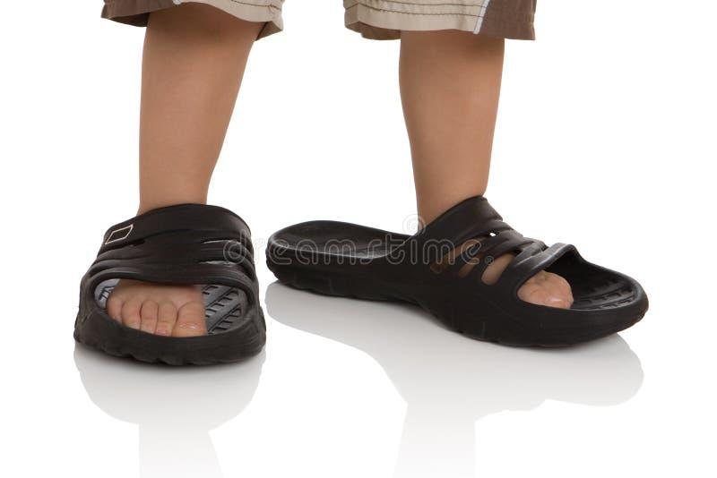 儿童英尺大s拖鞋 免版税库存图片