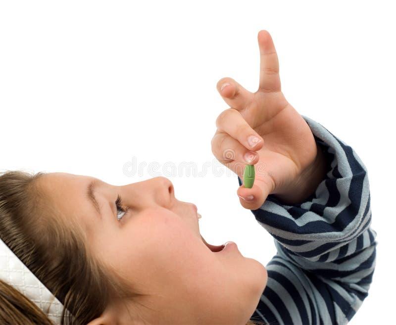 儿童药片采取 免版税库存图片