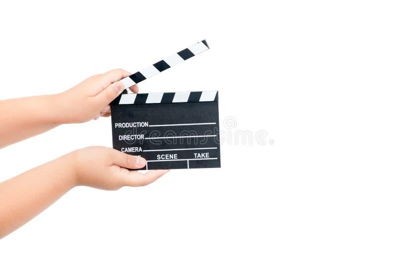 儿童藏品在白色隔绝的电影拍板 库存图片