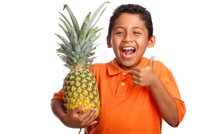 儿童藏品菠萝微笑的赞许 免版税图库摄影