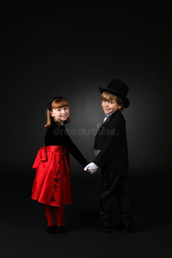 儿童衣裳逗人喜爱正式现有量暂挂 图库摄影