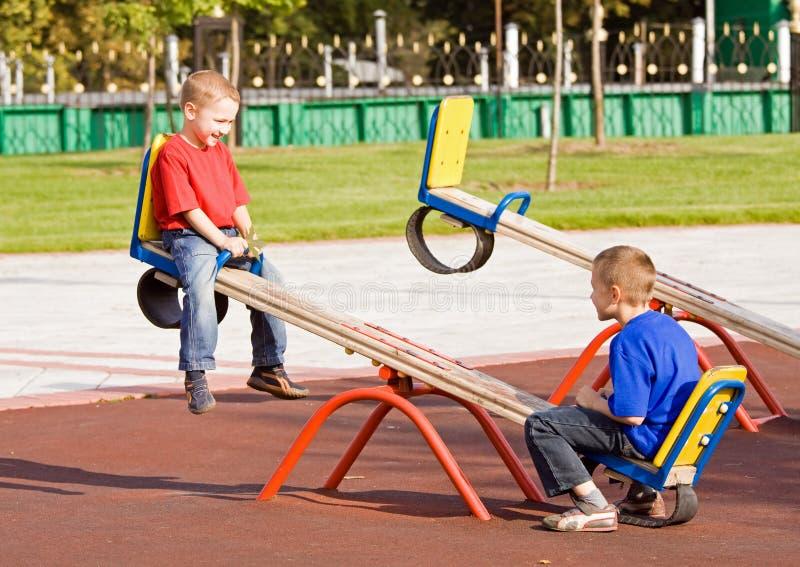 儿童跷跷板 免版税库存图片