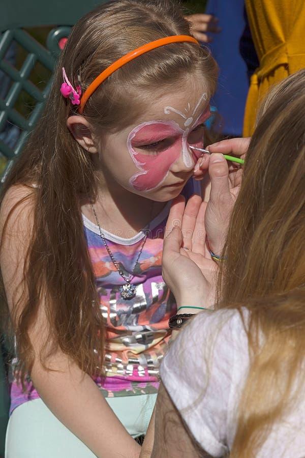 儿童面孔绘画的车间 免版税库存照片