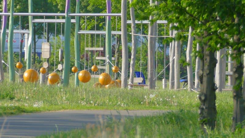 儿童` s操场在公园 免版税库存图片