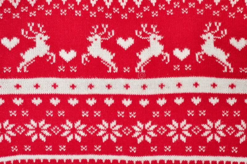 元素装饰圣诞节红色被编织的毛线衣特写镜头 节日礼物 Backgdound 免版税库存图片