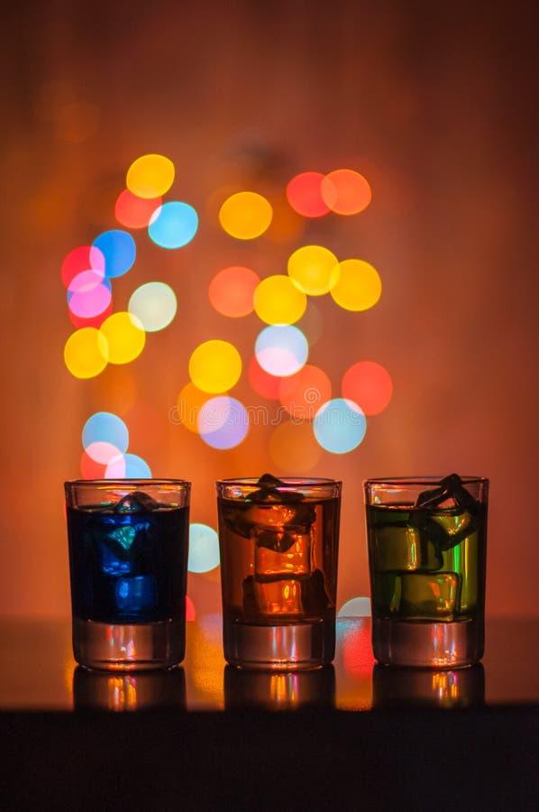 充分三个小玻璃被分类的饮料和 免版税库存图片