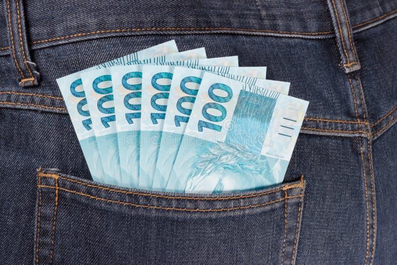 充分口袋的巴西金钱 图库摄影
