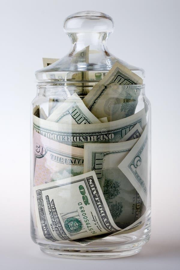 充分的玻璃瓶子货币 免版税库存照片