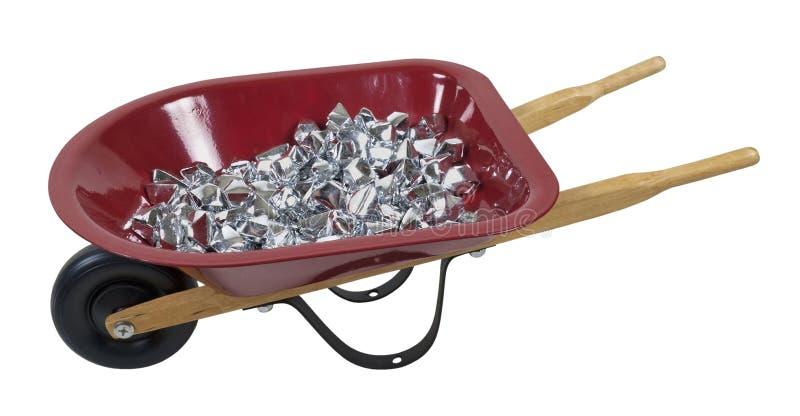 充分的银向独轮车扔石头 免版税库存图片