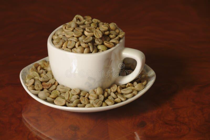 充分种族的顶视图未经焙烧的咖啡种子 库存照片