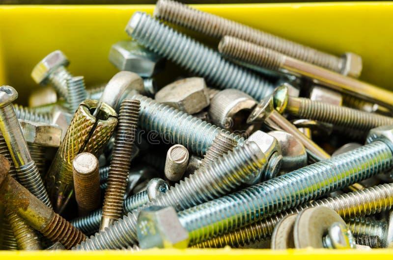 充分装箱老螺栓、另外情况和大小 免版税库存照片