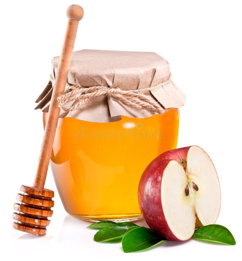 充分玻璃罐头苹果蜂蜜、片断和木浸染工 库存图片