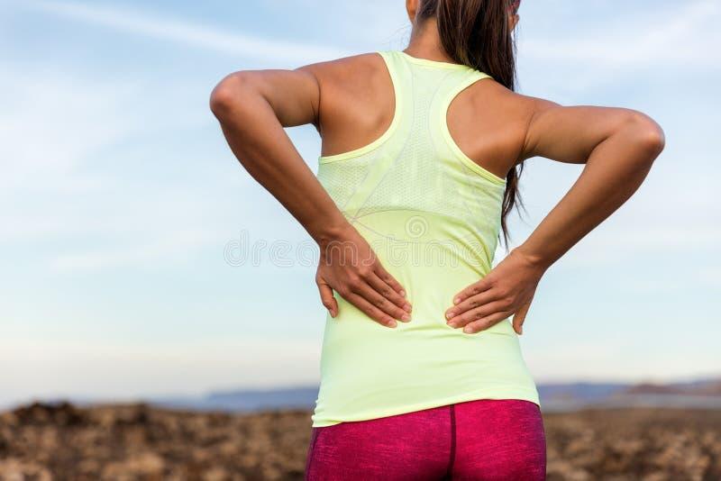 充满腰下部痛的足迹连续赛跑者 库存照片