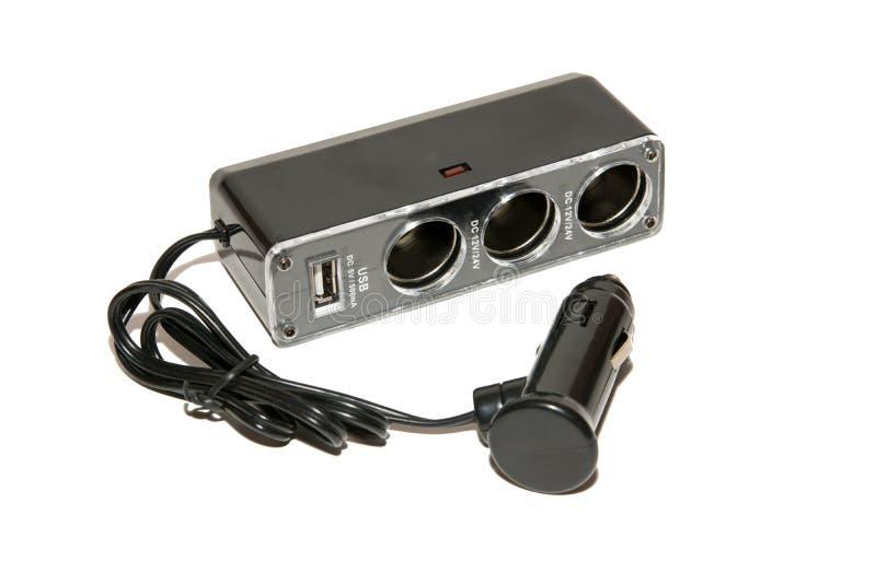充电的USB设备适配器从汽车香烟打火机 免版税库存图片