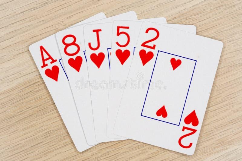 充足的心脏-打啤牌牌的赌博娱乐场 免版税库存图片