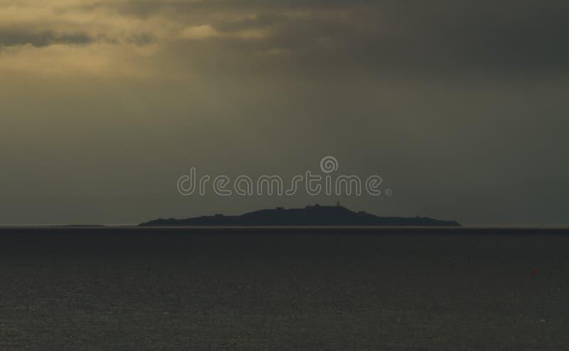 光柱在海岛上的 库存图片