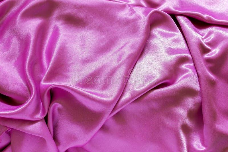 光滑的典雅的桃红色丝绸 能使用作为背景 免版税库存照片