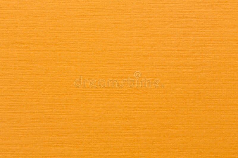 光滑的淡桔色的毛毡织品背景纹理顶视图 免版税图库摄影