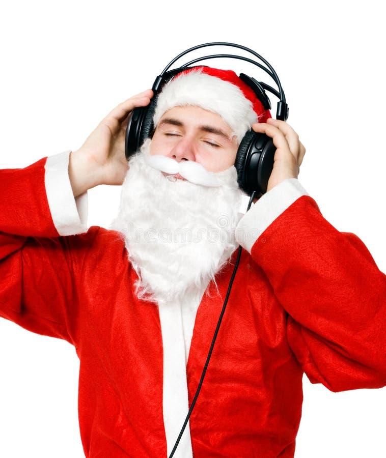 克劳斯听的音乐圣诞老人 免版税库存照片