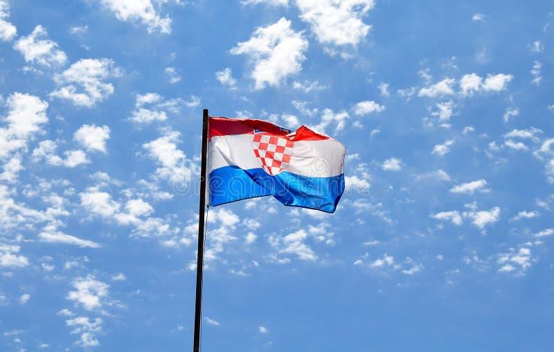 克罗地亚标志 挥动在多云天空的克罗地亚的旗子 概念 图库摄影
