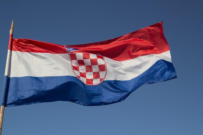 克罗地亚的旗子反对蓝天的 图库摄影