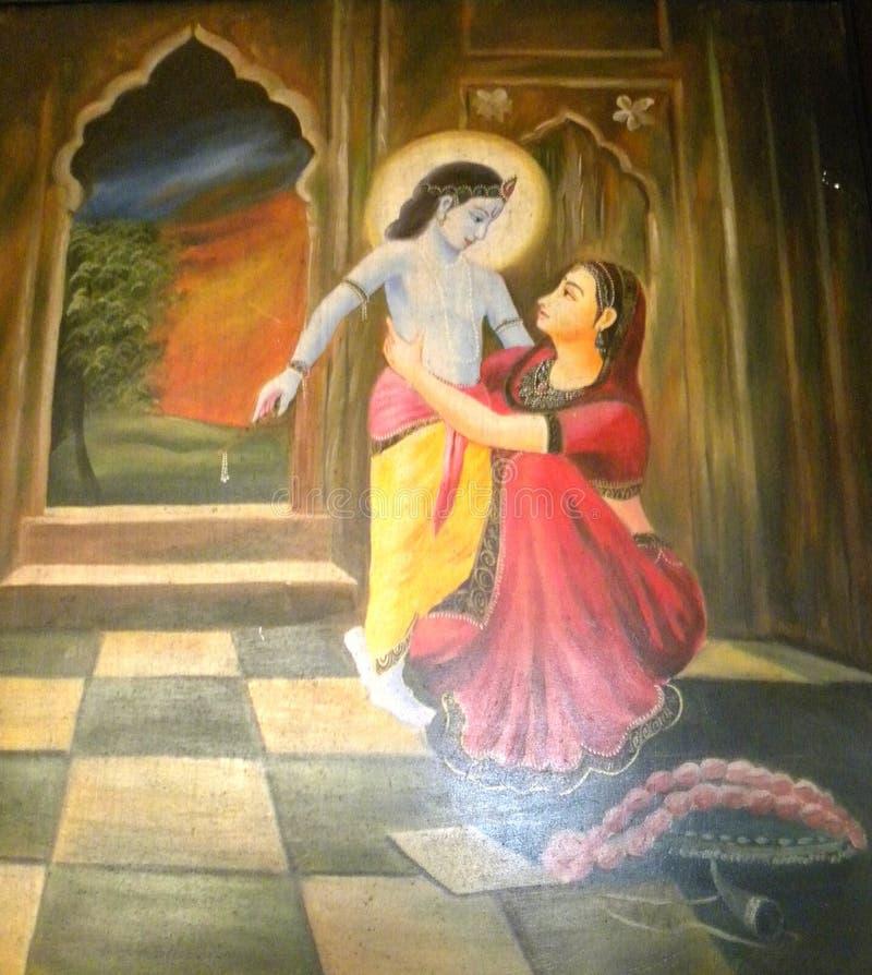 克里希纳阁下班格洛,印度- 2009 1月1日,五颜六色的绘画有母亲的Yashoda 库存图片