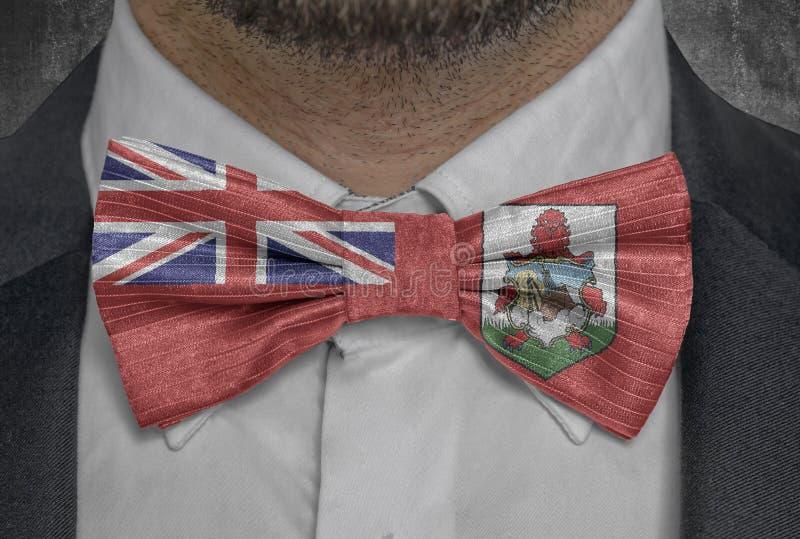 全国国家百慕大旗子bowtie商人衣服的 库存照片