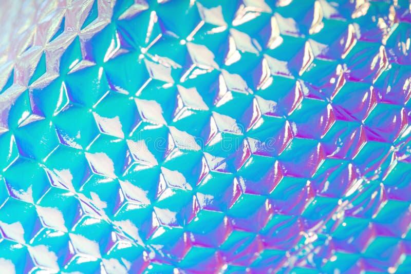 全息照相的紫外与几何样式的箔创造性的背景 免版税库存照片