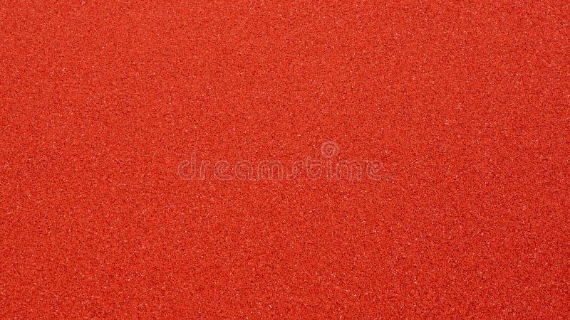 全新的红色室外篮球场地板特写镜头  免版税库存照片