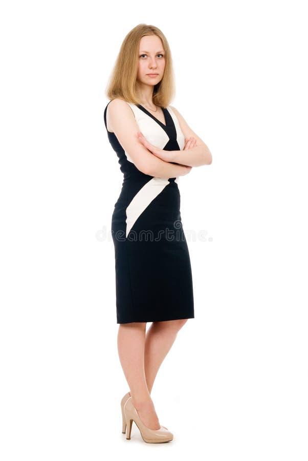 全长的年轻严肃的女商人。 免版税库存图片