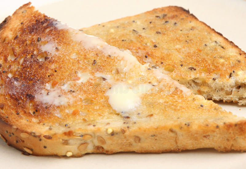 全麦的多士用黄油 库存照片