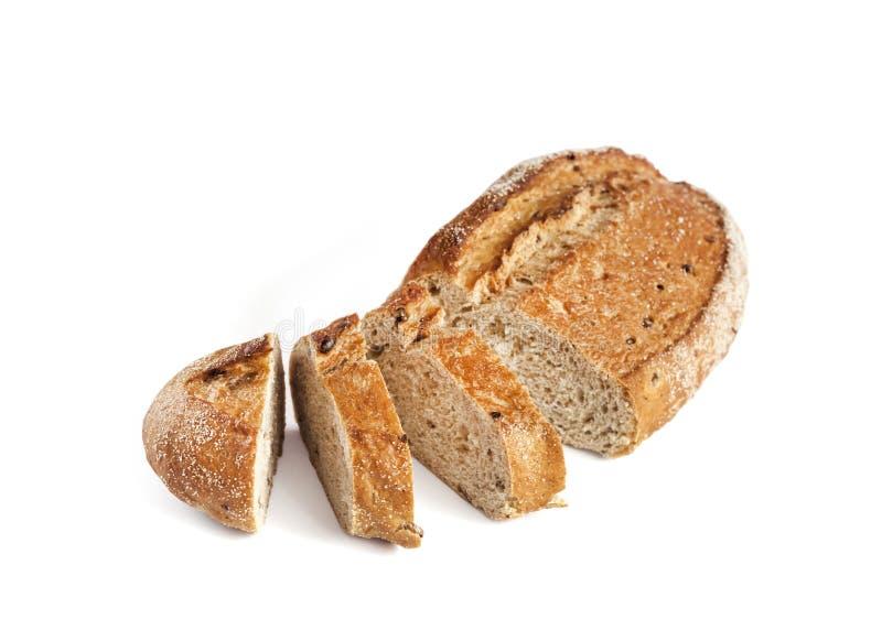 全麦面包大面包与在白色背景隔绝的切片的 免版税库存图片