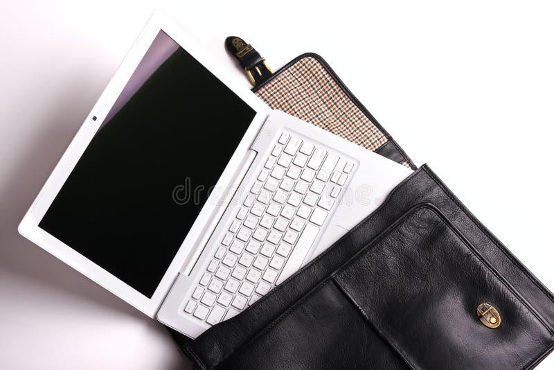 公事包膝上型计算机 免版税库存图片