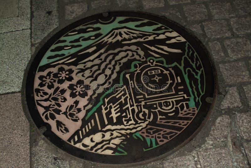 水公共通入的盖子在日本 免版税图库摄影