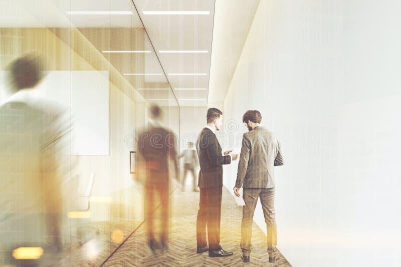 公司走廊的人,被定调子 免版税库存图片