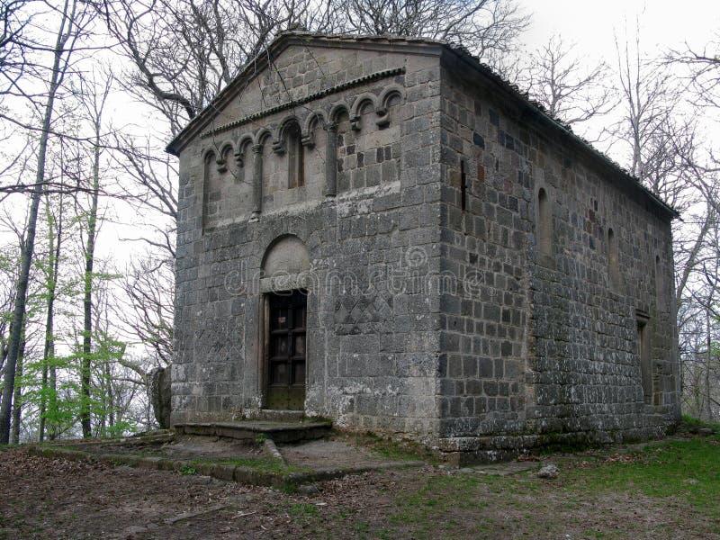 公墓的圣洁教会的教堂在圣Quirico d'Orcia在托斯卡纳 免版税库存图片