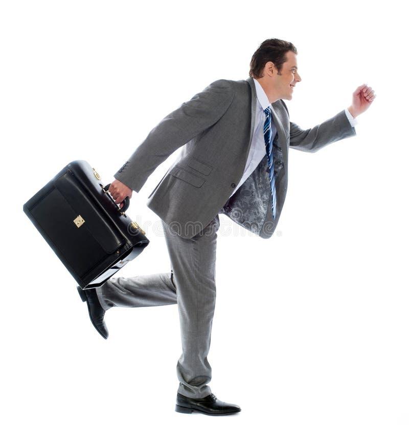 公文包生意人运行中 免版税库存图片