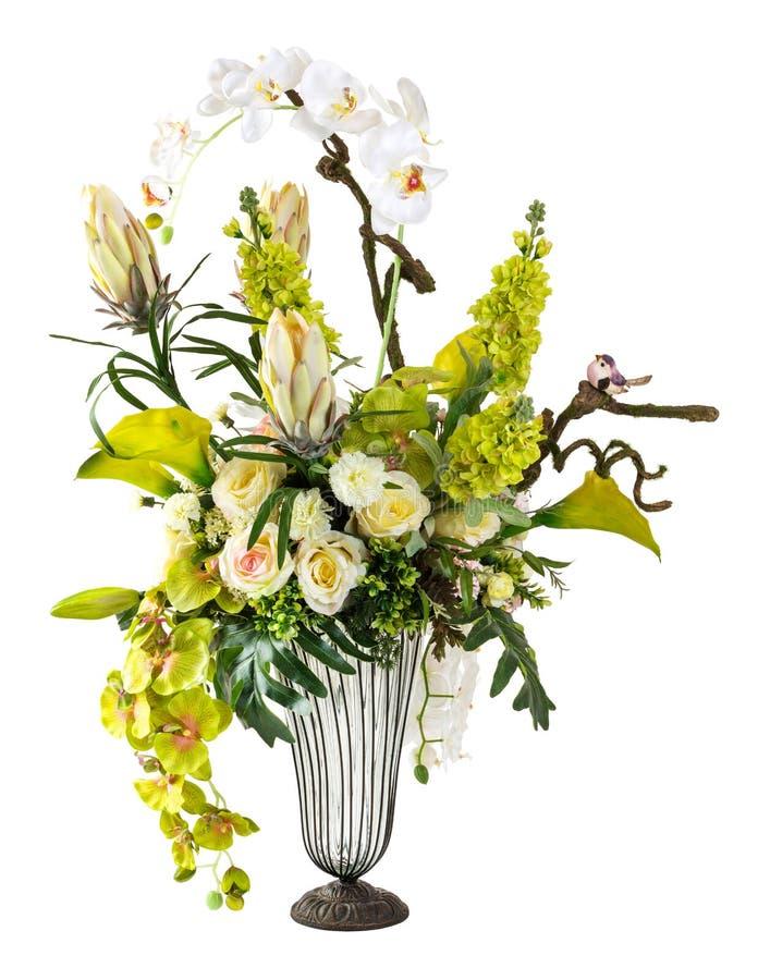 兰花和水芋百合花束在玻璃花瓶 免版税库存图片