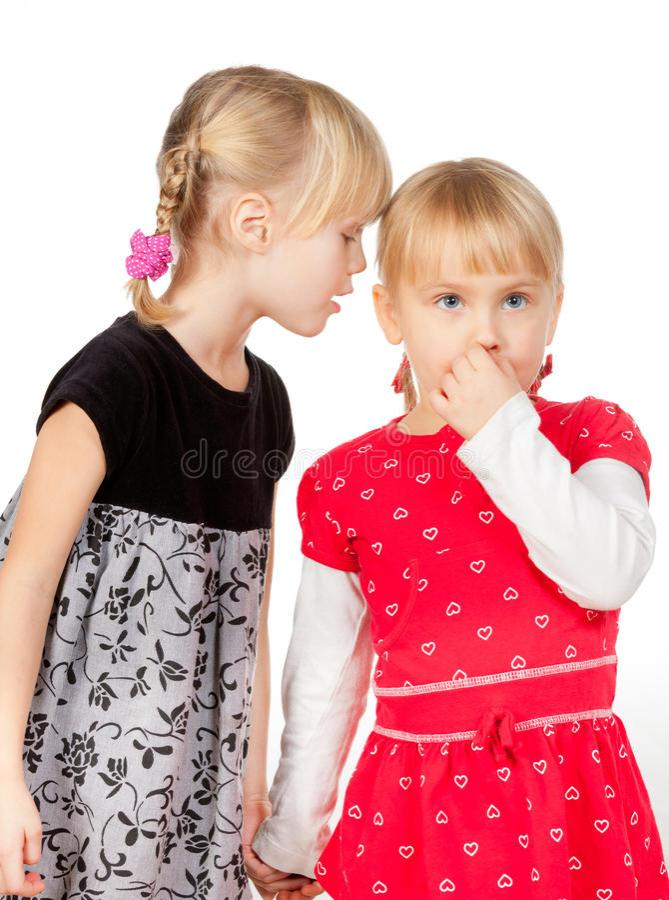 共享秘密的小女孩 图库摄影